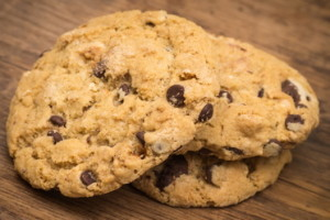 Chocolate chip cookies pile on wooden table