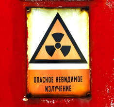 Radioactivity sign on a shelter door closeup